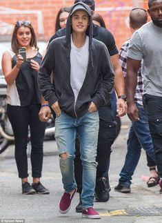 Helping hand: Justin Bieber reportedly comforted a young model after she claimed a drink was spiked at a party he attended in Melbourne on Saturday evening