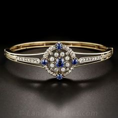 Beautifully hand crafted in the 1800s in silver over 14 karat yellow gold, 1.20 carats of impressively matched bright-blue sapphires are set at compass points inside double-diamond circlets. A…MoreMore  #vintagejewelry