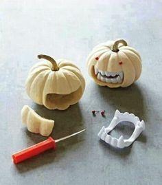 halloween deko ideen kürbis dekorieren kunstzähne rote augen