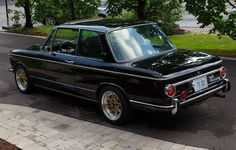 The BMW 2002 ti --- In 1968 BMW introduced this two-door midsize sedan, with a 2.0 liter four cylinder engine putting out 120 hp. In a time when the average performance was 51 hp, these were real sports car values ​​. The 2002ti reached a top speed of 185 km / h, also due to its sports chassis with all independent suspension, a complex rear axle and front disc brakes, This makes the BMW 2002ti the founder of sports sedans. ---- http://betterparts.org/bmw/bmw-weitere-modelle/bmw-2002ti.html