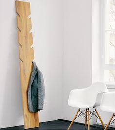 coat rack, wood, leans against wall