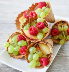 Fruit Cones | Kirbie's Cravings. Easy fancy ideas for displaying fruit. Just stuff fruit in the waffle cones and you're set! =)  http://kirbiecravings.com/2014/09/fruit-cones.html
