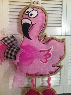 Hey, I found this really awesome Etsy listing at http://www.etsy.com/listing/153594547/flamingo-burlap-door-hanger