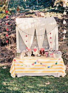 love the layered tablecloths, stripes, and garland and maybe white flags in background?