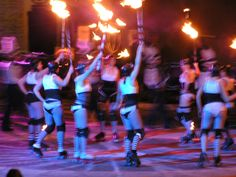 More from the Flam Chen + rollergirls performance. After we played with poi, we got sticks of fire!