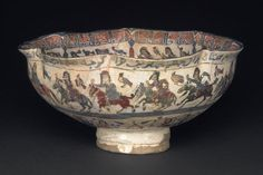 Iran probably Kashan Lobed Bowl with Seated Figure and Attendants, late 12th/early 13th century; Saljuq Period