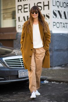 Cream sweater layered with two-tone coat and pants