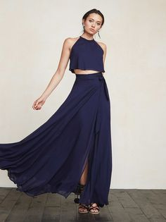 No summer wedding collection would be complete without a two piece - because let's face it, it's hot out there and a dress cut in half makes it a little cooler. This is a georgette set that includes a loose-fitting crop top with a high neckline and a split back with hook closure. https://www.thereformation.com/products/harper-two-piece-sapphire?utm_source=pinterest&utm_medium=organic&utm_campaign=PinterestOwnedPins