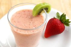 Strawberry Kiwi Smoothie! Here is a tip to peel a kiwi: slice off each end, then use a small spoon to get underneath the skin and work your way around. Then just slice the kiwi out - it is as simple as that!