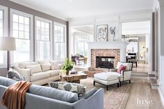 Contemporary White Family Room with Brick Fireplace
