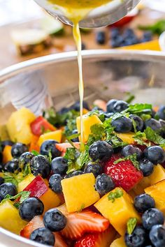 Honey Lime Rainbow Fruit Salad with fresh strawberries and more!
