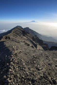 Mount Meru (the fifth highest mountain in Africa) with Kilimanjaro in the background. #MountKilimanjaro #Africa #Tanzania