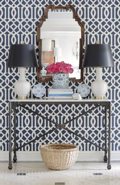 Exquisite foyer features Kelly Wearstler Imperial Navy Trellis Wallpaper framing scroll mirror over iron console table topped with white lamps accented with black vinyl lamp shades. Design Entrée, House Design, Trellis Wallpaper, Bold Wallpaper, Hallway Wallpaper, Accent Wallpaper, Graphic Wallpaper, Kitchen Wallpaper, Geometric Wallpaper