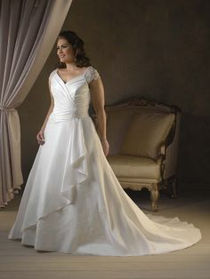 #ballgowns #weddings #weddinggowns #plussizebrides | plus size bridal gowns | cap sleeved bridal gown for fuller figured brides | Our American company offers plus size brides affordable custom bridal gowns as well as inexpensive replicas of couture wedding dresses.