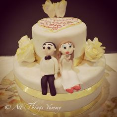 A #twotier #golden #anniversary #cake with a very special #message :) #bride #groom #goldandwhite #flowers #goldenflowers #weddingcake #figurines #bowtie #atyummy