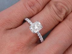 This is our bright 2.00 ctw Cushion Cut Diamond Engagement Ring. It has an awesome 1.51 carat Cushion Cut H Color/SI1 Clarity (Clarity Enhanced) Center Diamond. Set in an elegant setting and cast in 14K White Gold, this ring is listed for $3,790. Please inquire about a matching wedding ring! Cushion Cut Diamond Ring, Cushion Cut Engagement Ring, Cushion Cut Diamonds, Engagement Rings, Radiant Cut, Wedding Matches, Diamond Shapes, White Gold, Cushions