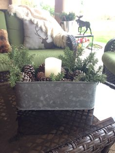 Galvanized tub from #Goodwill filled with #winter greens and a candle for outdoor decor. #thrift #decor #rustic