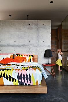 Pannekoecke-home-master-bedroom-bright-print-concrete