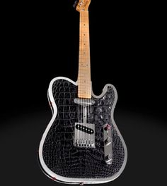 Rock Royalty, a new Nashville-based luxury design house that manufactures one-of-a-kind, custom guitars, is offering the ultimate in rock star decadence: an $85,000 custom alligator skin, diamond and sterling silver Fender Telecaster. The eye-popping instrument comes wrapped in exquisite natural black alligator skin from Louisiana, and features black diamond and sterling silver volume knobs, a selector switch set with rubies, and six handmade diamond tuning keys set in sterling silver.