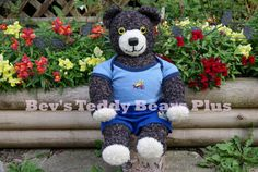 Mikey - 20 inches tall, Crocheted Teddy Bear sitting with Snapdragons.  He has moveable arms and legs.
