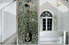 love the tiled wall (that conceals the water pipes) in the middle of the glass