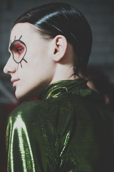 Metallic green and slicked hair backstage at Katie Eary AW15 LCM. See more here: http://www.dazeddigital.com/fashion/article/23178/1/katie-eary-aw15