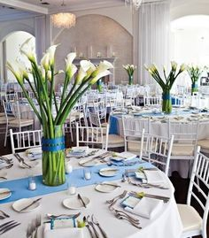 Blue and white reception decor with tall calla lily centerpieces