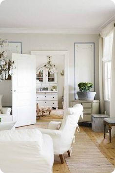 Frog Hill Designs Blog White Scandinavian modern living room.  Casual and clean.  Love the minimal color palette and casual furnishings. #whitelivingroom #scandinaviandesign