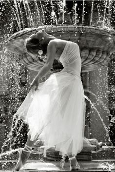 and she danced amongst the water droplets jb