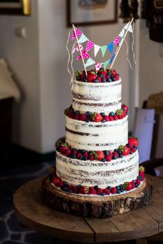 Thinly iced cake with berries. Such a pretty wedding or party cake!