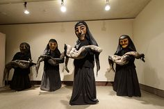 'Iraqi Women with Corpses,' part of the Bread and Puppet Theater exhibit at the Benton Museum on May 22, 2015. (Peter Morenus/UConn Photo)