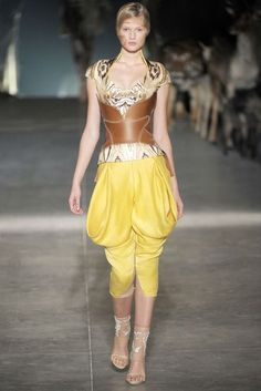 This image is from Alexander McQueen's Spring 2009 collection. This look is inspired by Renaissance dress, particularly venetian breeches which were worn by men and could be quite full in appearance.