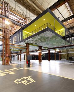 Completed in 2011 in Rotterdam, The Netherlands. Images by Theo Peekstok. In the heart of the ports of Rotterdam, Groosman Partners Architecten used a crane track in a former machine hall to suspend 1000 of office space. Factory Architecture, Architecture Office, Architecture Design, Architecture Panel, Parque Industrial, Industrial Architecture, Conception D'entrepôts, Design Commercial, Warehouse Design