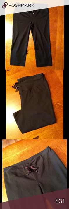 Cute Zella cropped work out pants! Women's Zella cropped workout pants in size large.  Nice wide comfortable waistband.  Waistband has a nice adjustable tie.  Cut out tag has been removed.  Pants measure a 32 inch waistband and 20 1/2 inch inseam.  Reflective features also on pants. 6 in slit on back of each leg with reflective strips. Pants have been worn but are in like new condition. Zella Pants Ankle & Cropped