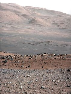 This photo from NASA's Mars rover Curiosity shows the layered geologic history of the base of Mount Sharp, the 3-mile-high mountain rising from the center of Gale Crater. The foreground terrain rises to a crest about 755 feet (230 meters) away from the rover.