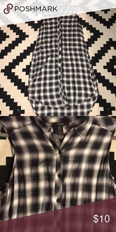 Plaid Sleeveless Top Gently worn. You can pair it with jeans 👖 shorts or wear it open like a vest or kimono. Forever 21 Tops