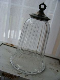 diy cloche made with a glass candle or lamp sconce and cast off  silver lid