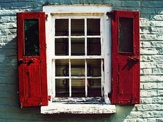 Red shutters hanging on a paned window Old Windows, Windows And Doors, Red Shutters, Hello July, Rustic Doors, Rustic Shutters, Terracota, Window Dressings, Old Doors