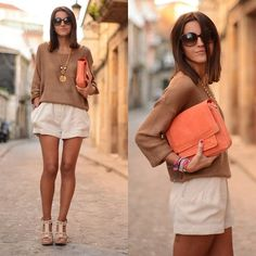 beige/brown sweater and white shorts