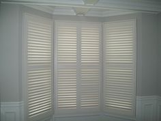 Shutters with a divider rail