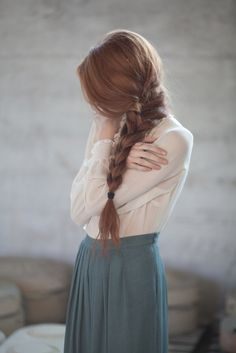 Girl with a long side braid