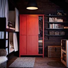 Clothing storage in an energetic red is as covetable as the wardrobe held within. | HEMNES wardrobe in red, @IKEA USA