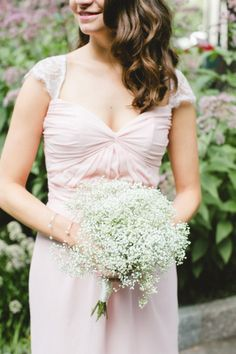 Try baby's breath: http://www.stylemepretty.com/2015/04/16/get-the-look-wedding-flower-alternatives/