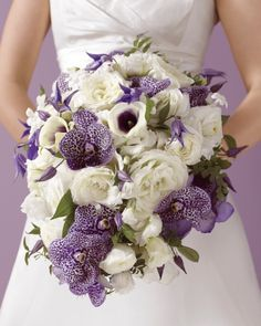 A winning hand featuring Vanda orchids and clematis in purple