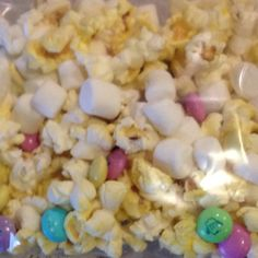 M&Ms, Popcorn, and Marshmallows oh my! My Girl Scouts love this snack.