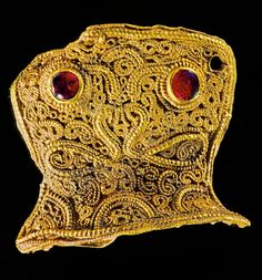 Sword hilt from the ancient Staffordshire Hoard. Intricate craftsmanship that you won't find coming out of Chinese sweatshops today.
