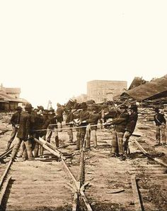 """Atlanta, Georgia… Sherman's Men Tearing Up Railroad Track. Photographed in 1864 by Barnard, George N. Sherman's 62,000 men marched out of Atlanta """"into the fat fields of Georgia like locusts devouring the land"""", Sherman tore up every mile of railroad track and almost every station."""