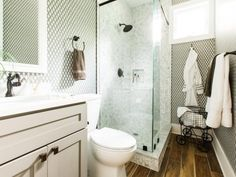 The welcoming guest bathroom with geometric patterned walls and inviting glass enclosed shower creates a chic retreat for visitors at HGTV Dream Home Guest Bathroom Colors, Guest Bathrooms, Dream Bathrooms, Beautiful Bathrooms, Marble Bathrooms, Bathroom Island, Bathroom Pictures, Bathroom Ideas, Kitchen Pictures