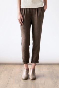 Tapered-leg silhouette pants with cropped hems made from a light and breathable linen fabric. Designed and made by Ode to Sunday