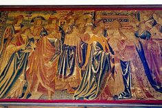 Medieval tapestry, Lyme Regis-On the north wall of the north aisle of St. Michael's church is this rare surviving British tapestry, dating to the late 15th century. The scene depicted celebrates the marriage of Henry VII to Elizabeth of York.